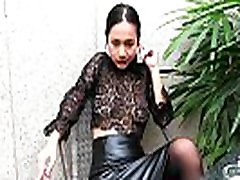 Young girl showing wet panty smokes topless and in leather skirt
