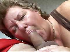 Mature Slut sucking a Juicy Cock