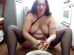 mature inem sex with a big tits masturbates in the kitchen