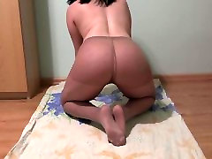 Brunette pees in nylon stockings, and on foot