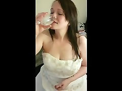 Slut Drinks Glass of Cum In Wedding Dress
