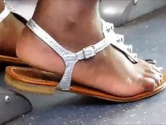 Ebony beautiful feet in sandals edit