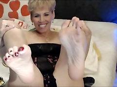 Mature shows big feet on webcam