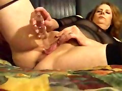 Mature oiled anal fisting masturbates to orgasm
