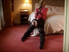 Tied lady in black pantyhose