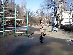 Russian MILF dance in overknee boots and short skirt