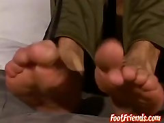 Brandon loves showing his feet while wanking his big cock