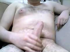 Hung Irish guy plays with his thick uncut cock
