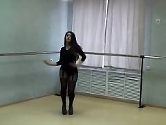 Extremly hot girl in sexy blindfolded milf and high heels dancing