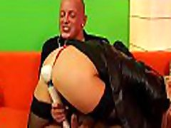 Pretty lesbian babe moans hard with two big toys on cunt