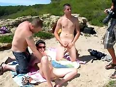 Brunette on beach has sex and cum on tits