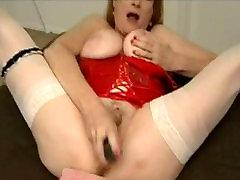 Busty mature in stockings fucks dildo