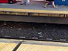 Midget with thick legs across platform