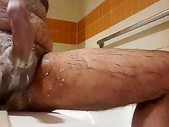 Soapy jerk off in shower. Nice cum shot. Hairy bear
