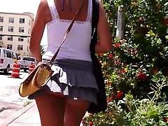 Summer windy day lifts short skirt