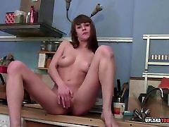 Perfect hairy pusy deep masturbates on the kitchen counter
