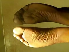 Soles arches view in shaved monkeys nylon socks, pink toes and one na