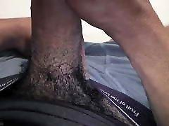 Black dude rubbing his boner 2