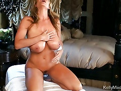 Busty Kelly Madison plays with her tubes nekad tits