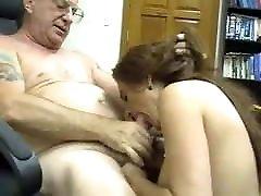 Young girl sucking a older men