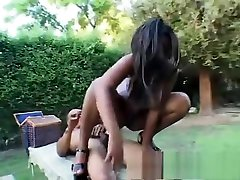 Busty ebony Shawna passes time at the barbecue by blowing and screwing