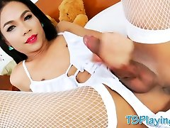 Beautiful ladyboy masturbates her hard dick on the bed