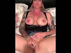 Hot tattooed wife playing and toying with her pussy