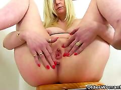 English milf Fiona rubs her fanny in the bathroom