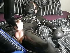 Jerking off a tied up rubber guy