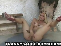 Foxy blonde shemale vixen tugging on her cock