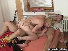 Mature lady enjoys two fresh cocks
