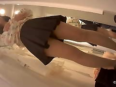 Asian girl with pad in panty in changing room