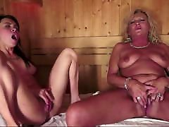 A liz wi takes care of a hot little brunette in the sauna