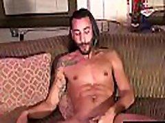 Handsome tattooed jock with pierced nipples solo masturbates