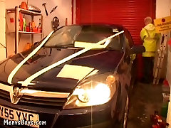 Young car mechanic servicing older gay businessman
