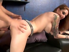Busty redhead knows how to handle a dick