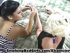 Two teens smoke glass pipe on bed