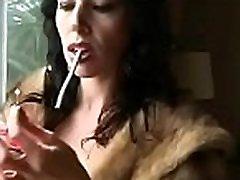Ebony sucks a small jock while holding a lit cigarette