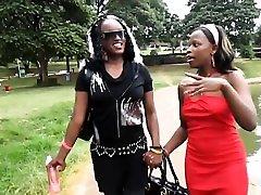 Ebony Lesbians enjoy taking a stroll near the lake. After
