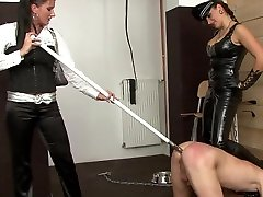 Two cubby cute girl ladies whipping male slave