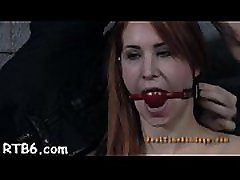 Caged hotty gets a lusty whipping for her smooth arse