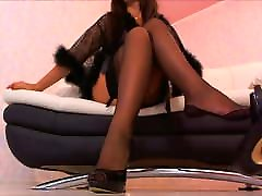 Brunette teases in sexy stockings and high heels