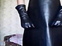Guy wanks in long leather gloves