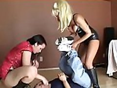 Hot gals smothering a dude with their tits and booties
