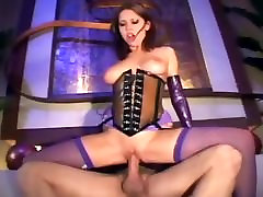 Sex in a latex corset and purple fishnet