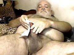 Hairy polar bear fingers his ass