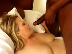 Mature blonde sham butey polishes the top of a BBC