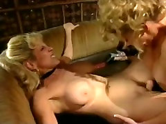 Randi Storm Fucked by Johnni Black with a Strap On Dildo