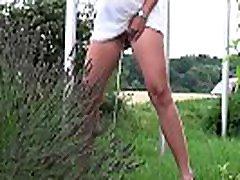 Blonde pees in public outside