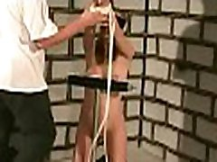 Exposed wife stands tied up and endures heavy breast bondage